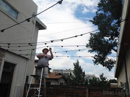 Hanging Patio Lights String Hanging Bistro Lights Outdoor Style How To Hang Commercial Grade