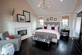 contemporary master bedroom with hardwood floors by