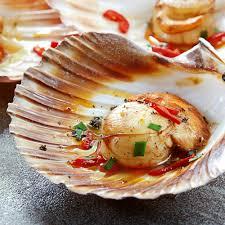 cuisiner le corail des coquilles jacques recette coquilles jacques flambées