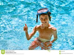 boy kid child eight years old inside swimming pool portrait happy