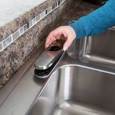 placing deck plate over gaskets in faucet installation