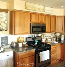 Decorating Ideas For The Top Of Kitchen Cabinets Pictures Greenery Above Kitchen Cabinets Faced