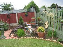 tropical inexpensive diy rock landscapes red fence wall in back
