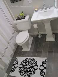 Bathroom Floor Tile by Soothing Gray Tile Set In A Herringbone Pattern Give This Small