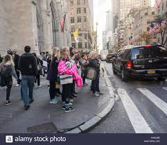 shoppers laden with their pink purchases in new york on sunday
