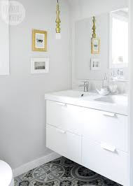 a tiny bathroom sprinkled with golden touches style at home