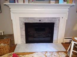 amusing white brick painted fireplace mantel also black iron frame