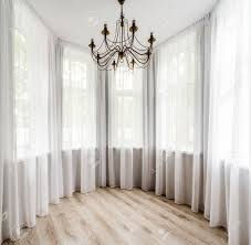 elegant room interior with wooden floor white curtain and