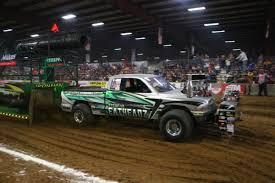 outlaw monster truck show digging in to the farm show field four wheel drive u2013 miles beyond 300