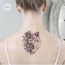 flower wolf on the back by zlata kolomoyskaya