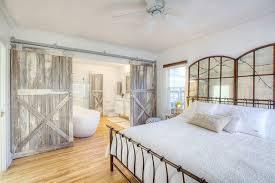 Reclaimed Wood Interior Doors Bedrooms Farmhouse Style Bedroom With Reclaimed Wood Barn Doors