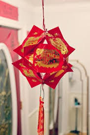 Make Lunar New Year Decorations diy chinese new year fan for little ones could add string