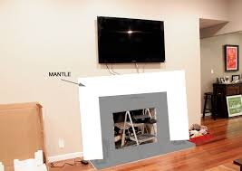 tv above fireplace ideas cable box tv above fireplace ideas cable