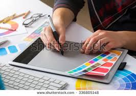 young cute graphic designer using graphics stock photo 410481883