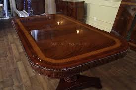narrow regency style inlaid mahogany dining table seats 10 12
