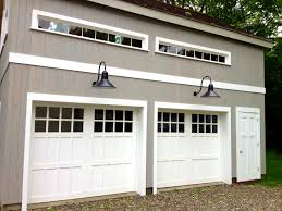 manly design doors single carriage pella series carriage house to