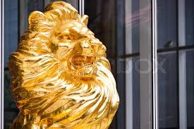gold lion statue gold lion statue in front of building stock photo colourbox