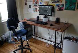built a desk for the wife with iron pipe and a door diy