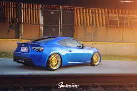 custom blue subaru blue subaru brz wearing gold avant garde wheels wrapped in nitto