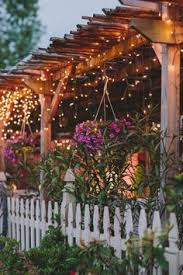 Outdoor Pergola Lights by How To Plan And Hang Patio Lights Patio Lighting Pergolas And