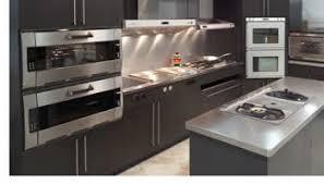 model kitchen by frigo design with stainless steel backsplash
