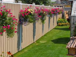 Hanging Plants For Patio 15 Fence Planters That U0027ll Have You Loving Your Privacy Fence Again