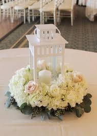 white lantern centerpieces in bloom florist weddings white lantern centerpiece