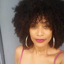tami roman looks stunning in curly wig