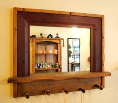 entryway mirror with vintage tool handle pegs empty spaces design