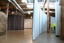 Hanging Room Divider Panels by Using Curtains To Divide Rooms Our Hanging Room Dividers Act As