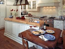 photo page hgtv french country kitchen with table built into the island