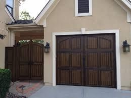 decorative garage door hardware with coastal bronze hardware installed