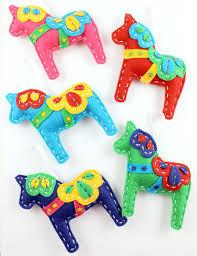 handmade felt dala embroidery ornament by lova revolutionary