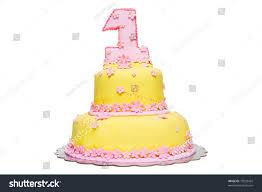 happy first birthday yellow fondant cake stock photo 73093429