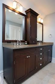 double sink vanity with middle tower hall bath keep large mirror put tower storage in the middle and