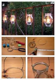 Outdoor Candle Wall Sconces Flat Iron Wall Sconce With Glass Hurricane On Either Side Of The