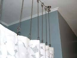 Hang Curtains From Ceiling Hanging Ceiling Curtain Rods The Homy Design Regarding Hanging