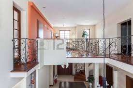 classy house living room interior with classic staircase stock