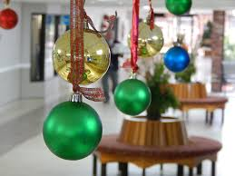 ornaments hanging from ceiling at front desk in atrium