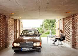 outbuilding of the week garage as lantern in the german wirth architects brick garage gardenista 5