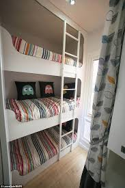 with fixed triple bunk beds on one end of the caravan and a sofa