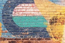 yellow green and blue brick wall free stock photo