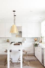 wood and brass swivel counter stools transitional kitchen