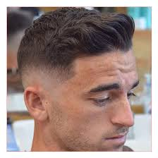 mens hairstyles mid length with thick brushed back hair with taper