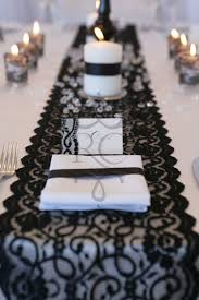 candle runners black lace runner with lace wrapped around votive candles for a