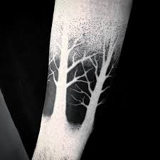 negative space black ink trees male tattoo ideas on forearm