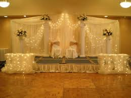 wedding backdrop chagne gold ivory chairs indoor reception wedding bridesmaids photos