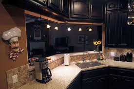 bathroom black merillat cabinets plus sink and lighting for