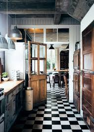 white kitchen cabinets black tile floor 43 practical and cool looking kitchen flooring ideas digsdigs