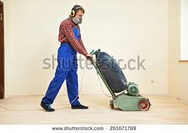 carpenter doing parquet wood floor polishing stock photo 261671789